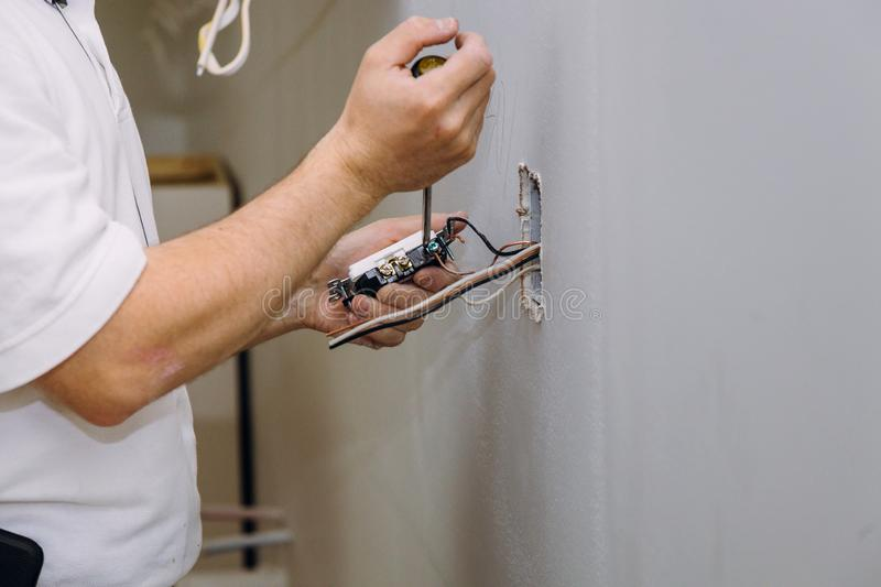 Work on installing electrical outlets. With electrical wires and connector installed in plasterboard drywall, house, installation, new, building, construction royalty free stock images