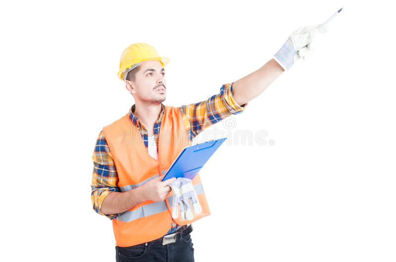 Work instructions concept with engineer taking notes and pointing pencil. Work instructions concept with constructor or engineer taking notes and pointing pencil stock photo