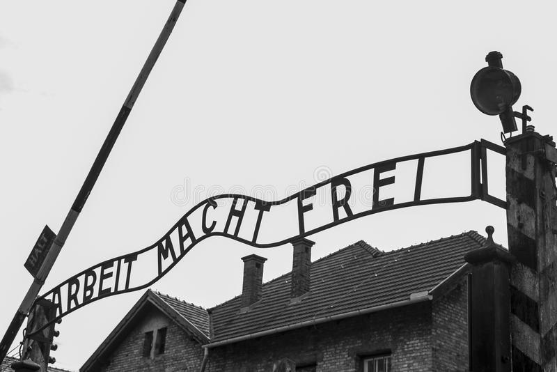 Work liberates entry sign concentration camp Auschwitz Birkenau KZ Poland. Work liberates entry sign of concentration camp Auschwitz Birkenau KZ Poland royalty free stock images