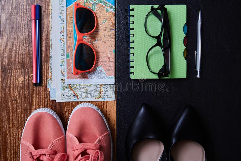 Work life balance choice concept. Accessories for leisure and work.  stock image