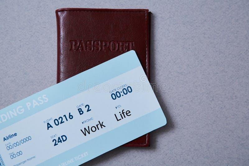 Work life balance choice concept. Boarding pass and passport.  royalty free stock photos