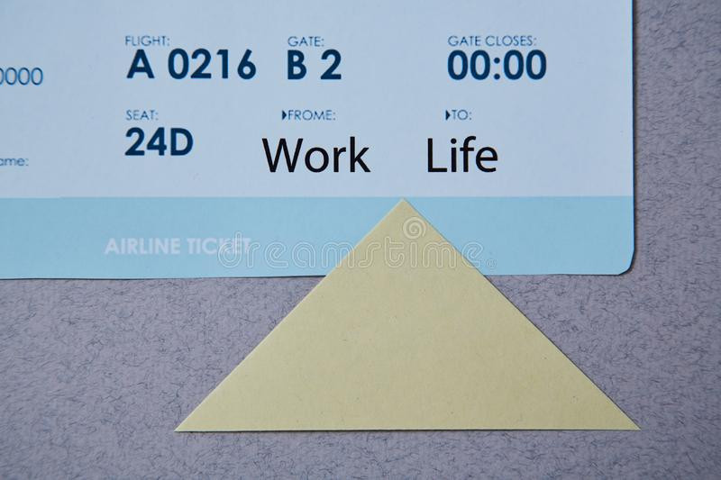 Work life balance choice concept. boarding pass and sticker.  royalty free stock image