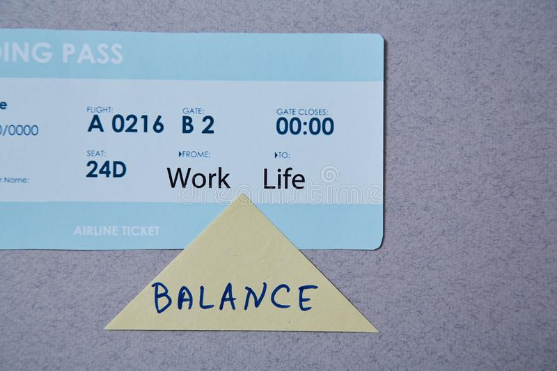 Work life balance choice concept. boarding pass and sticker.  stock photography
