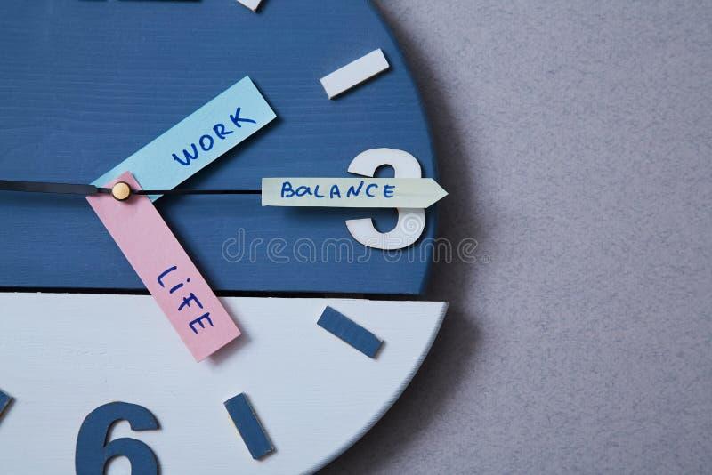 Work life balance choice concept. Clock closeup and arrows telling.  stock photos