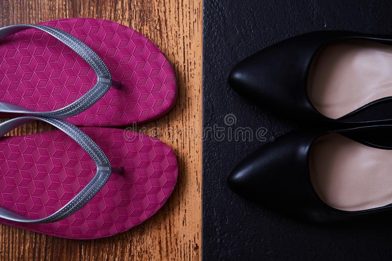 Work life balance choice concept: colored sandals or flip-flops and strict black office shoes royalty free stock image