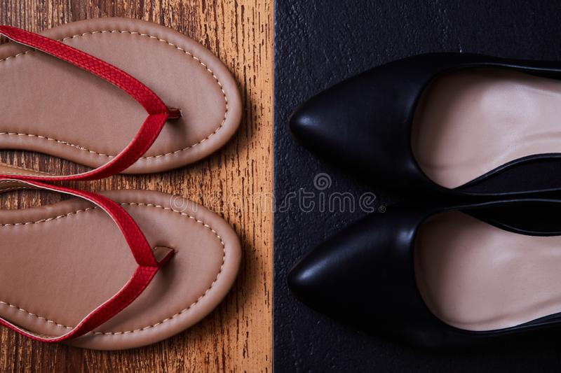 Work life balance choice concept: colored sandals or flip-flops and strict black office shoes.  royalty free stock photos