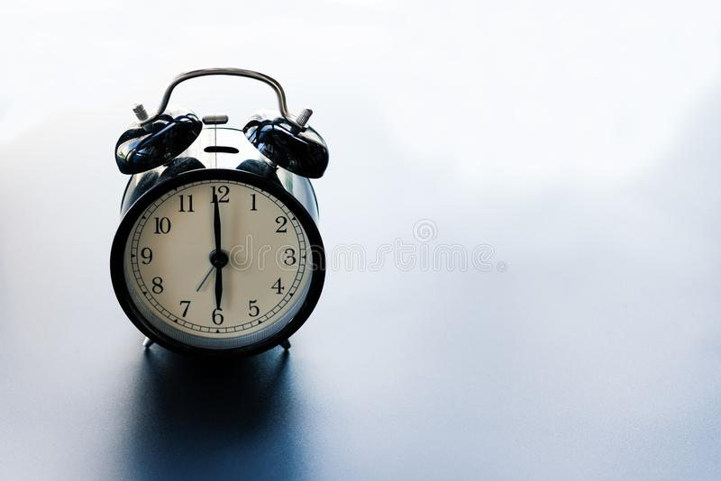 Work life balance concept, alarm clock with copy space royalty free stock image