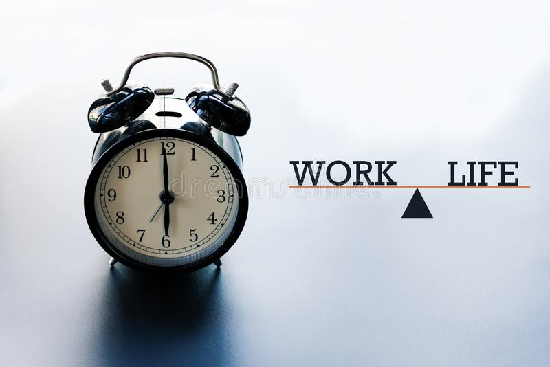 Work life balance concept, alarm clock with word Work and Life on illustration scale stock photos