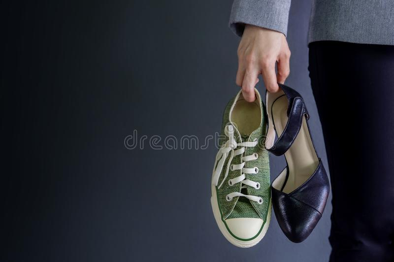 Work Life Balance Concept, present by Business Working Woman holding a High Heal and Sneaker Shoes, Croped image with Copy Space royalty free stock photos