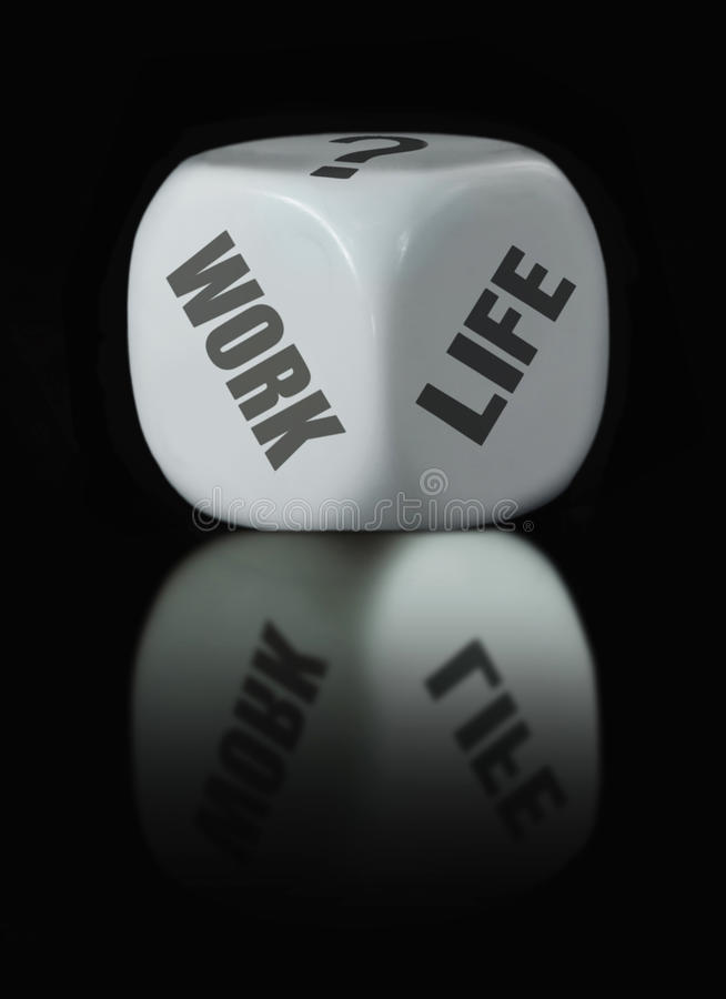 Work life balance. White dice with work life choices royalty free stock photos