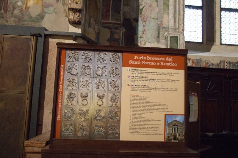 Work of Luciano Minguzzi The Bronze Doors, San Fermo Maggiore church, Verona, Italy. Italy, Verona - December 08 2017: the view of Luciano Minguzzi work The stock photography