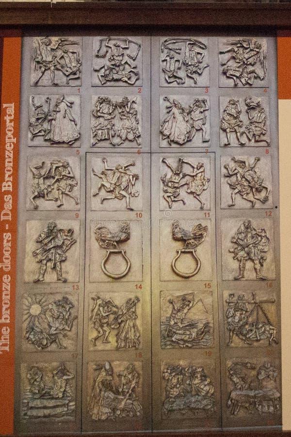 Work of Luciano Minguzzi The Bronze Doors, San Fermo Maggiore church, Verona, Italy. Italy, Verona - December 08 2017: the view of Luciano Minguzzi work The stock photos