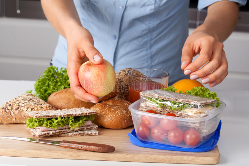 Work lunch packet. A woman preparing a lunch packet for work royalty free stock photo