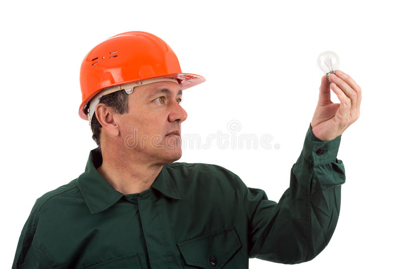 Work man electrician in uniform with bulb. Isolated on white stock photography