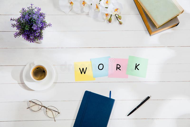 WORK. Message at colorful note papers on a desk background. stock photography