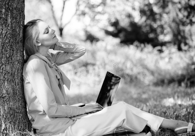 Work outdoors benefits. Woman with laptop work outdoors lean tree. Minute for relax. Education technology and internet stock photo