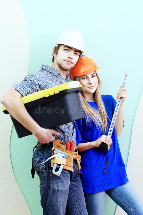 Work pair. Happy family making repairs at their new home stock images