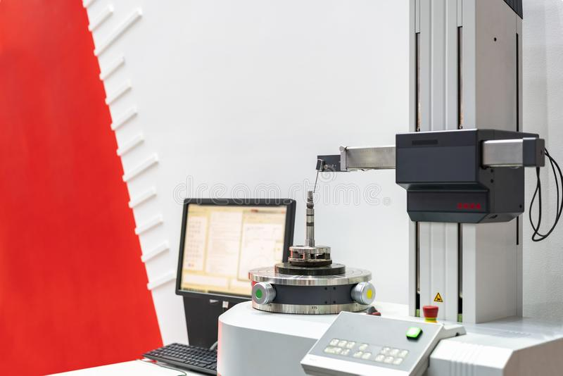 Work piece or various parts from manufacturing machine etc in industrial during continuous measuring or inspection surface of. Shape by high technology and stock photo