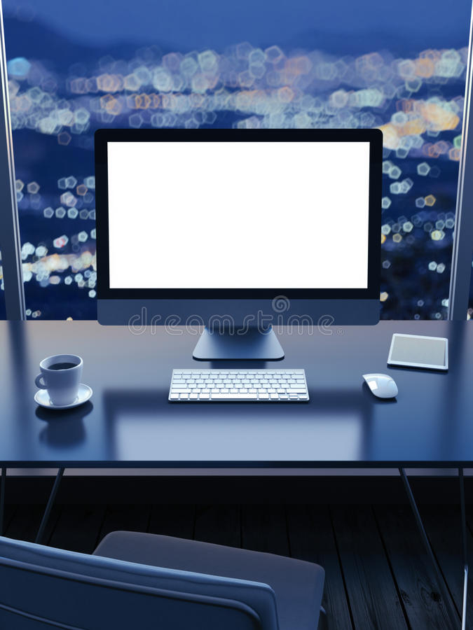 Work place with a city view from window at night stock photo