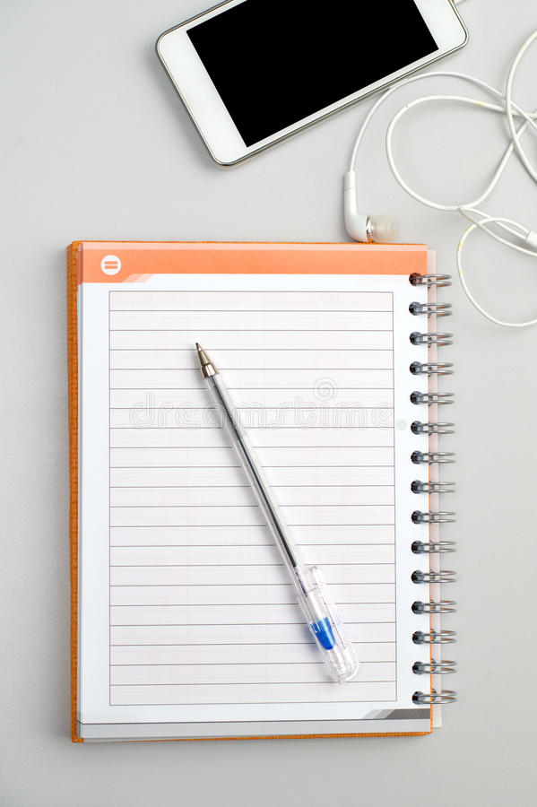 Work place with phone and notepad royalty free stock images