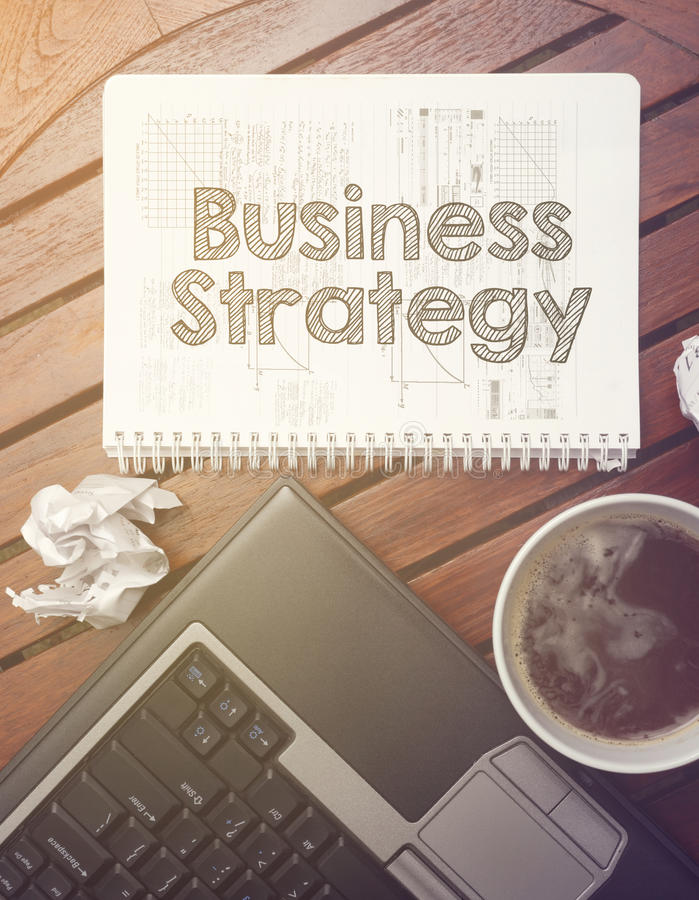 work place - table with notebook with note about: business strategy royalty free stock image