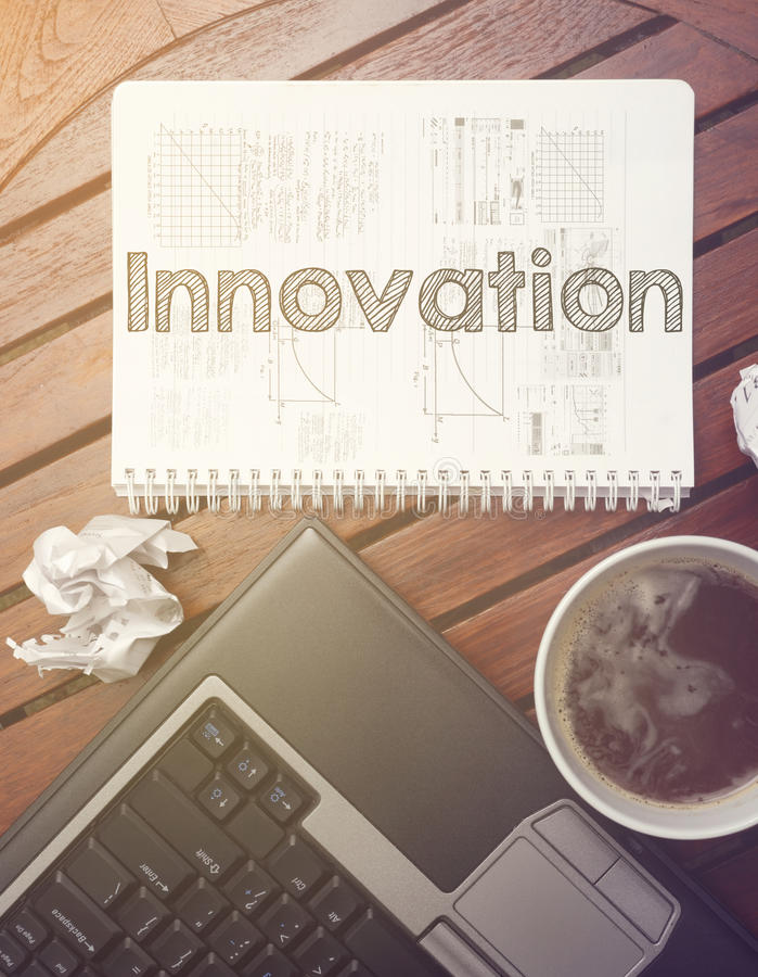 Work place - table with notebook with note about: innovation royalty free stock photography