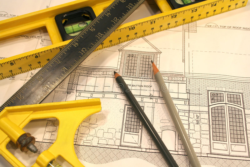 Work plans. Architectural drawings and tools of the trade royalty free stock images