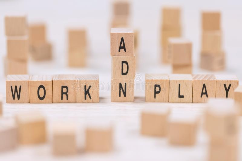 Work and play wooden cubes background. A work and play wooden cubes background stock photo
