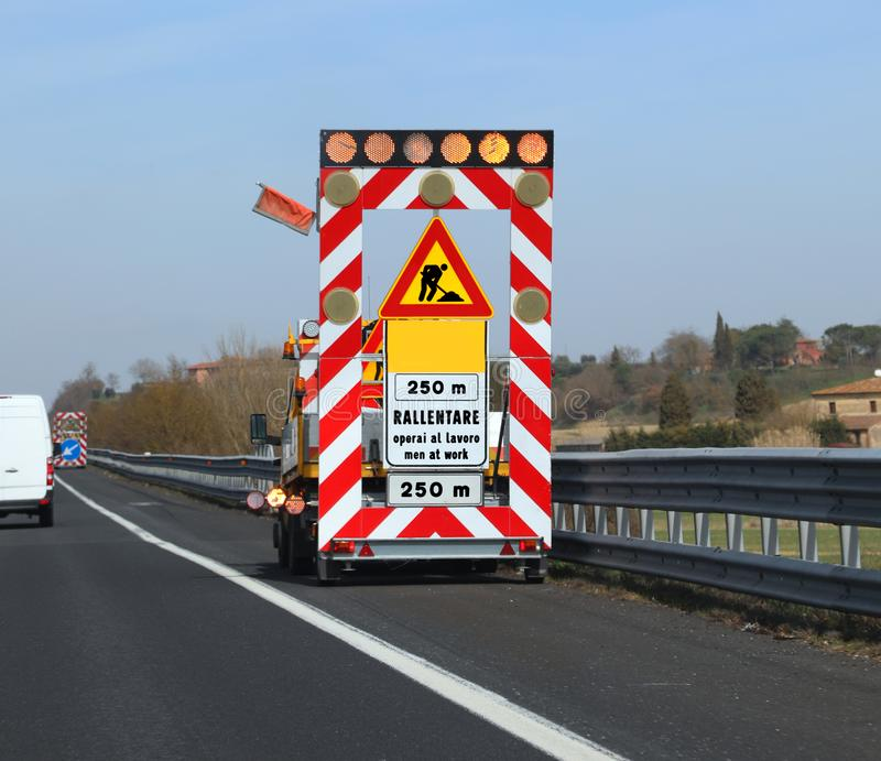 Work in progess in the italian road the text meas Reduce Speed. Work in progess in the highway the text meas Reduce speed because there are Men at Work in stock photos