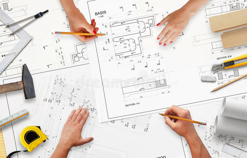 Work on project documentation in construction company. stock images