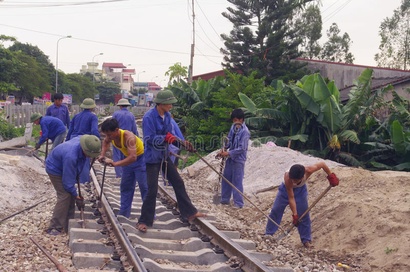 Work on the railway. The single-track railway from Hanoi to Ho Chi Minh City should be maintained between two train passages. The wooden sleepers are being stock photo