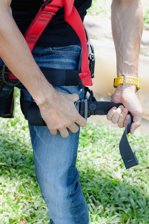Soft focus close up young man Asian wear the safety harness for job at height stock photo