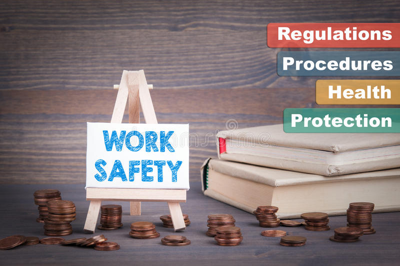 Work Safety Business Concept. Miniature easel with small change royalty free stock images