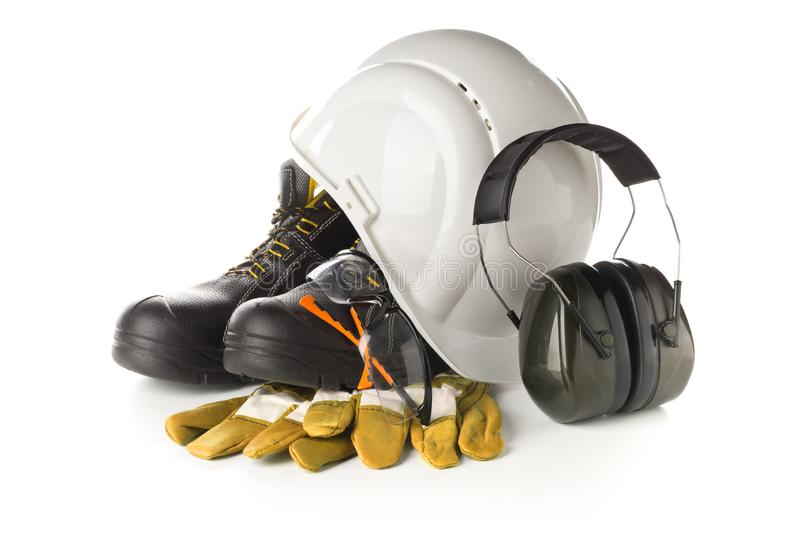 Work safety and protection equipment - protective shoes, safety glasses, gloves and hearing protection royalty free stock images