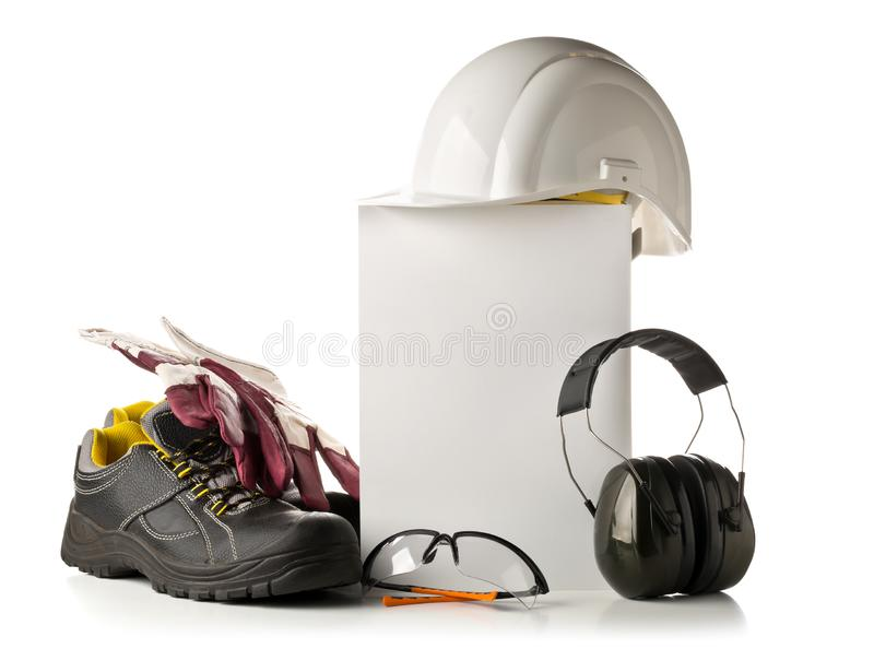 Work safety and protection equipment - protective shoes, safety. Glasses, gloves and hearing protection over white background with blank card for copy royalty free stock photos