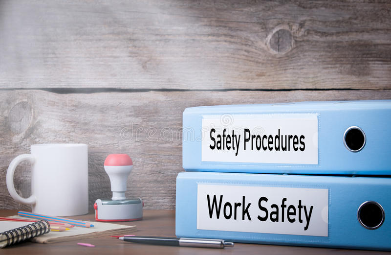 Work Safety and Safety Procedures. Two binders on desk in the office. Business background royalty free stock photo