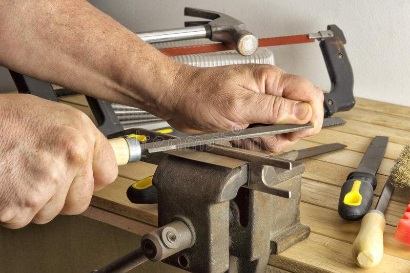 Work saws a file item hamstrung. Plumber sawing a file item hamstrung royalty free stock photos