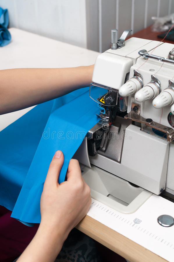 Download Work at the sewing machine stock image. Image of fabric - 28771189