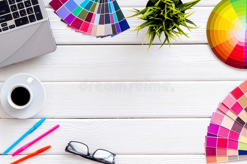 Work space of designer with instruments, pallet, laptop and coffee white wooden background top view space for text stock images