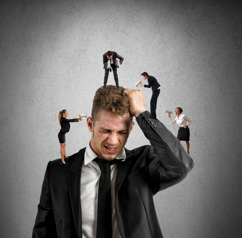 Work stress. Concept of stress at work with small people shouting with megaphone stock images