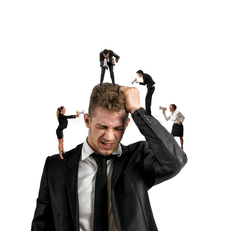 Work stress. Concept of stress at work with small people shouting with megaphone stock photo