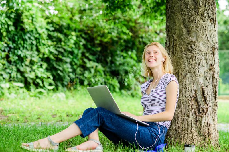 Work in summer park. Girl work with laptop in park. Reasons why you should take your work outside. Nature is essential. To wellbeing and ability to be stock photography