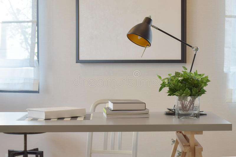 Work table with book lamp, and vase at home. Work table with book lamp, and vase at modern home royalty free stock images
