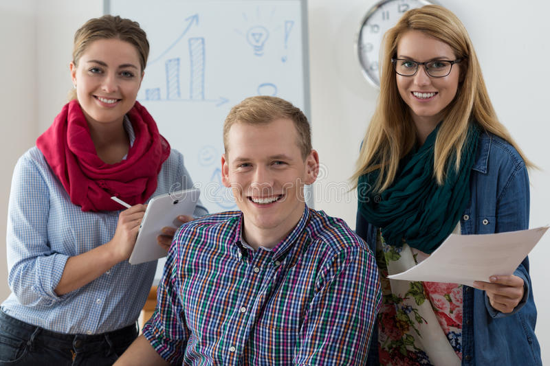 Work team of young adults royalty free stock photos