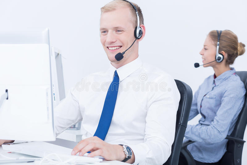 Work in telemarketing. Daily work in modern and friendly telemarketing office royalty free stock image