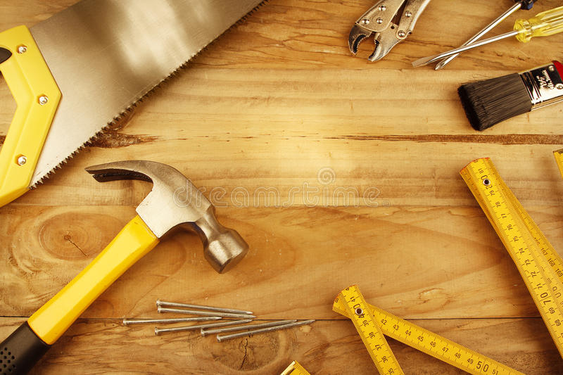 Work tools. A variety of tools on wood. Advertising space royalty free stock photos
