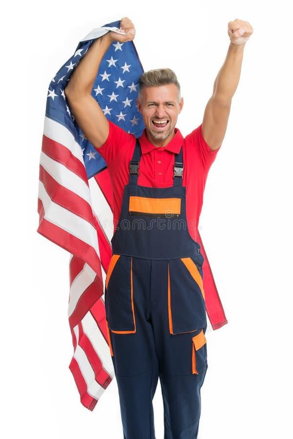 Work visa USA. Man cheerful laborer hold american flag. Repair and renovation. Repair tips. Guy worker in uniform royalty free stock photos