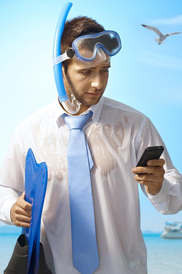 Workaholic man on holiday royalty free stock photo