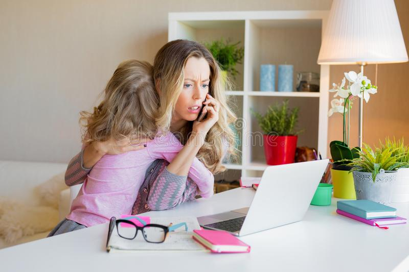 Workaholic mom too busy at work royalty free stock photos