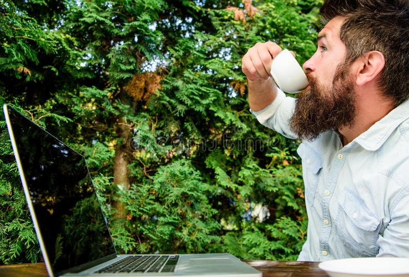 Workaholic stereotype. Drink coffee work faster. Bearded man freelance worker. Remote job. Freelance professional. Occupation. Online blog. Caffeine booster for stock photo